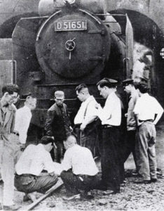 Investigators inspecting the train that killed Shimoyama.