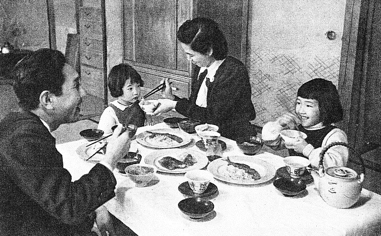 Japanese Family sharing a meal in the 1950's.